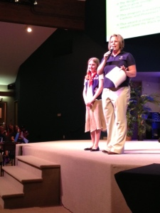 Our daughter receiving the PRAY award at American Heritage Girls