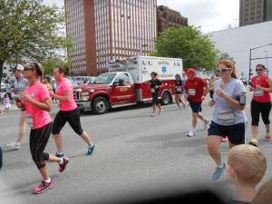 An ambulance trying to get through to an injured person during the Dam to Dam race in Des Moines on June 1.